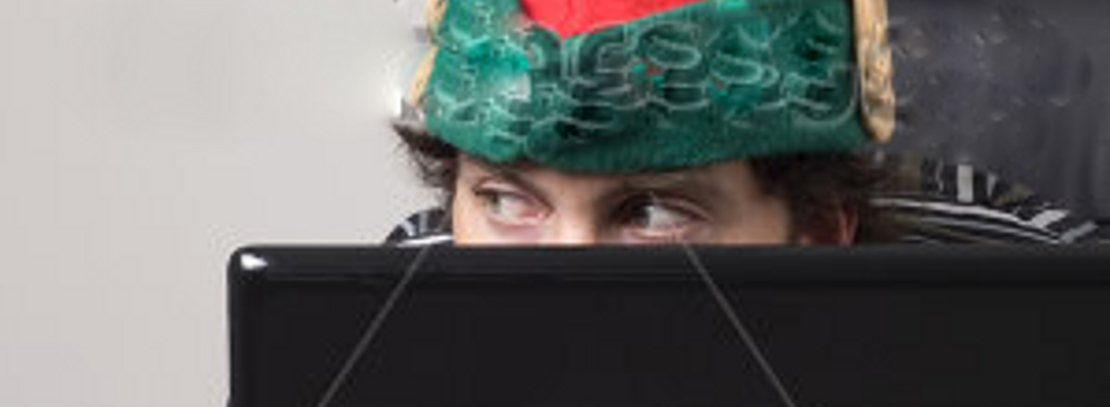 stock-photo-man-hiding-behind-laptop-with-elf-hat-39257599_resize
